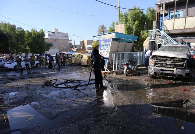 Twin blasts in Iraq kill 21, wound dozens