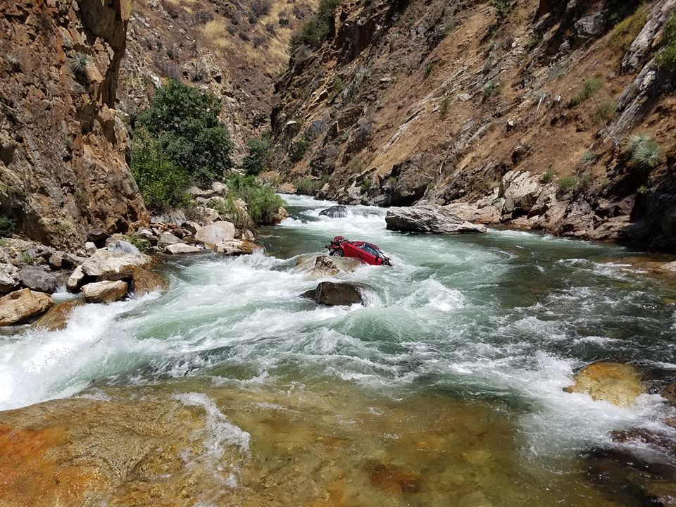 Rescuers seek to recover students' bodies from auto in California river