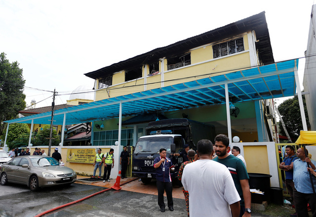Malaysia conducts burial of school fire victims