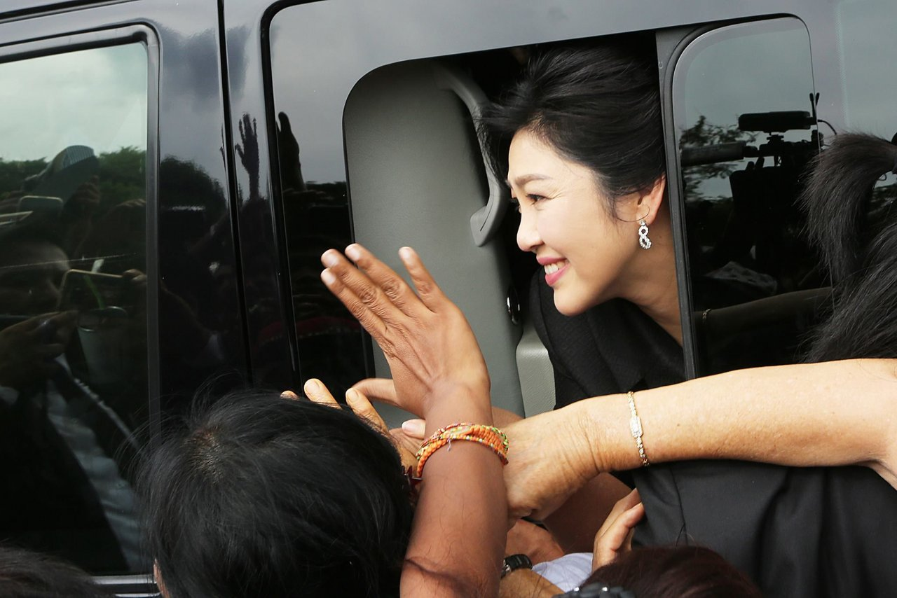Thai police search convicted PM Yingluck's house