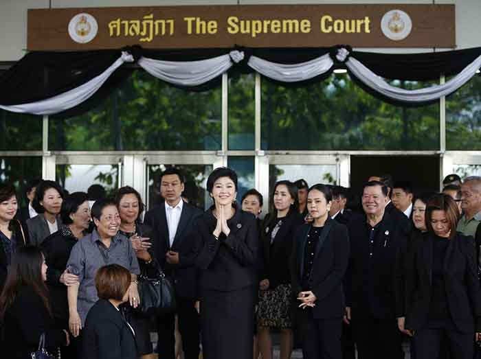 Thai court sentences ex-PM Yingluck in absentia to 5 years in jail