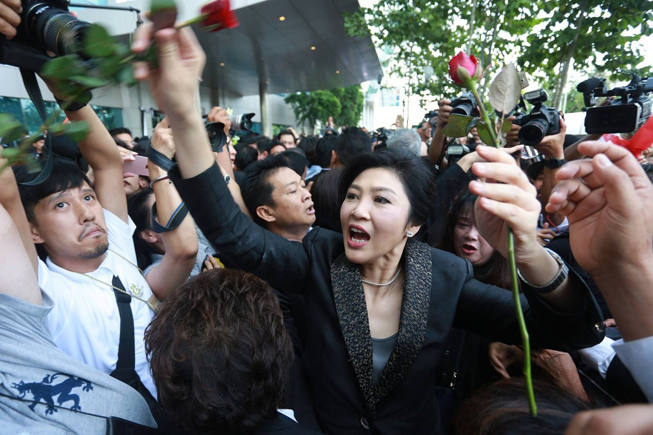 Yingluck in UK, Interpol red notice sought