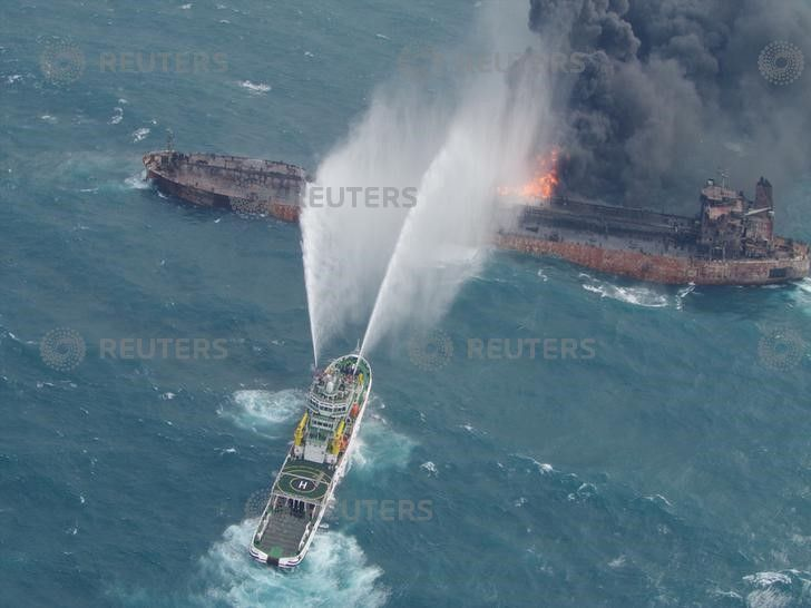 Iranian oil tanker burns for third day as winds, waves lash rescuers
