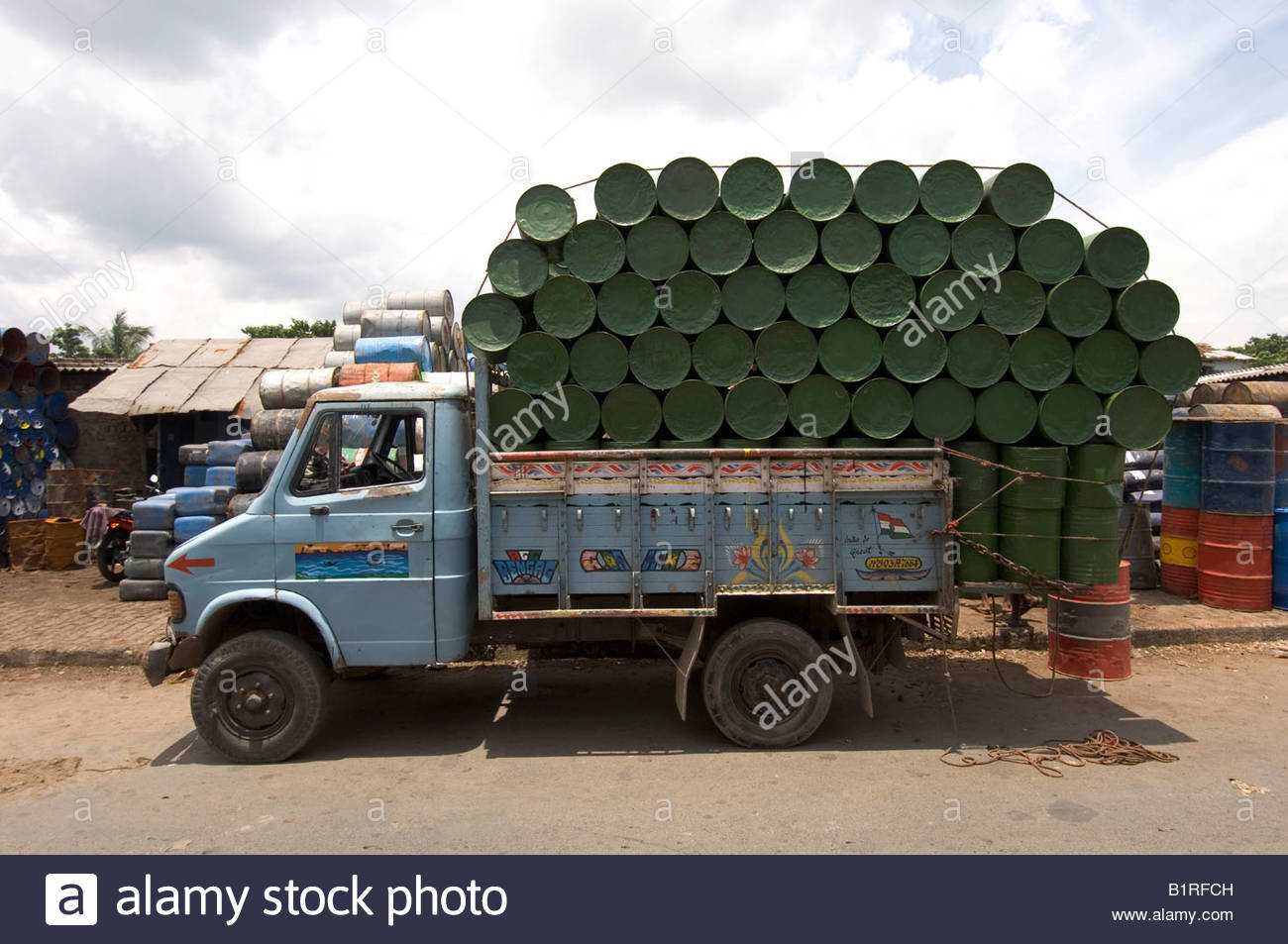 waste-processing-truck-loaded-with-newly-beaten-out-recycled-barrels-B1RFCH.jpg
