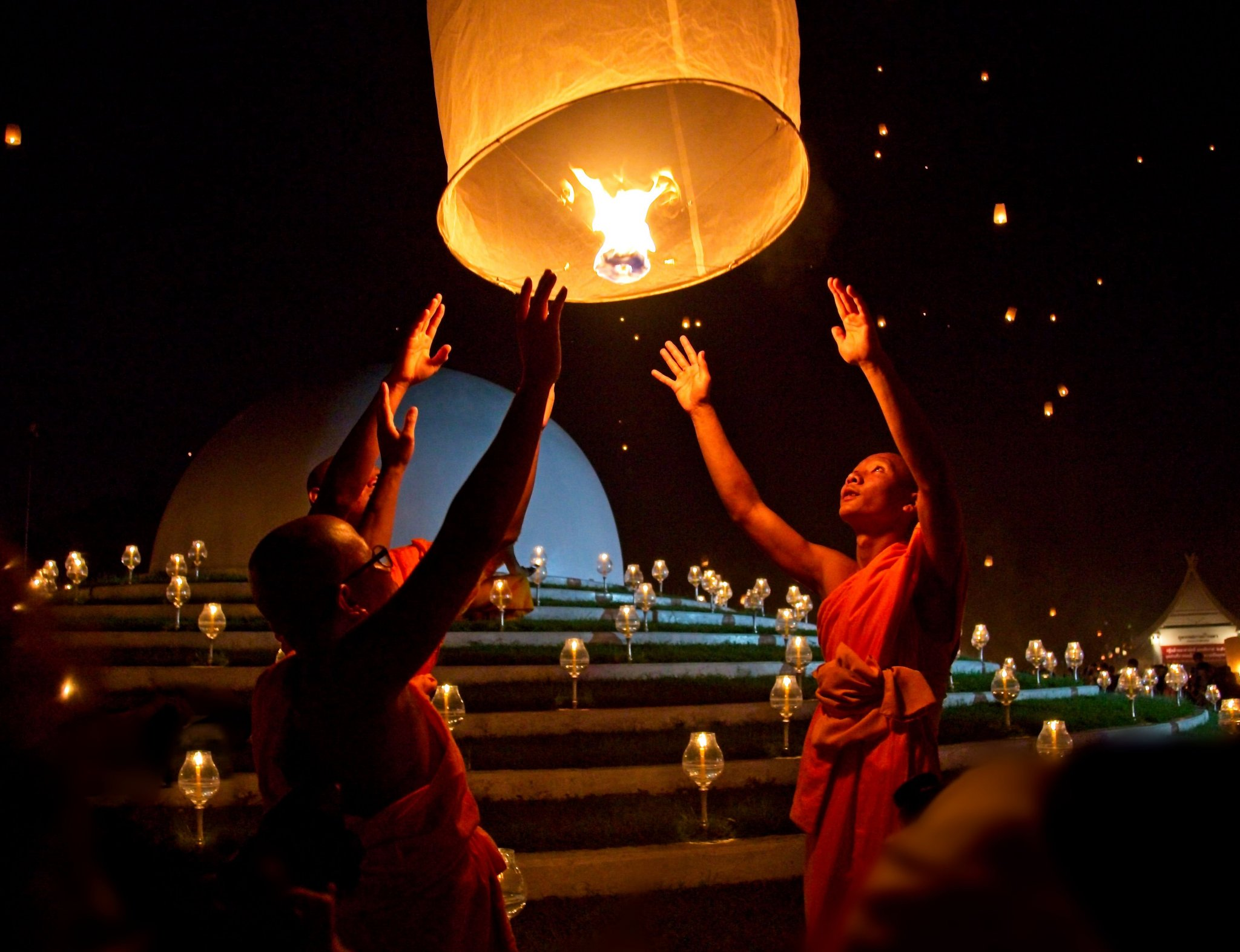 Monks Releasing Khom Loy.jpg