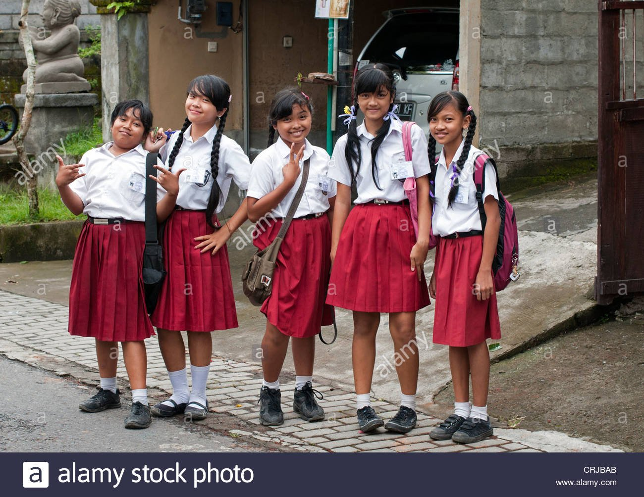 ubud-5-april-2011-young-school-girls-in-uniform-on-the-stret-having-CRJBAB.jpg