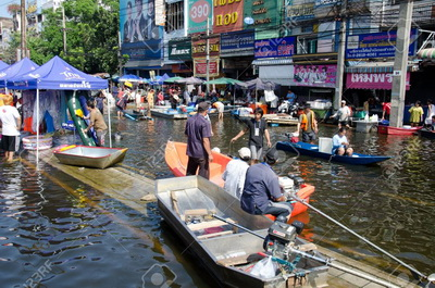 11249396-bangkok-thailand-november-13-transportation-of-people-in-the-streets-flooded-after-the-heaviest-mons.jpg